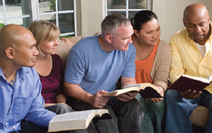 Five people studying the Bible